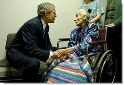 "President George W. Bush visits with 94-year-old Anna Tovcimak, who is a hospice patient, after a roundtable discussion on Medical Liability Reform at Mercy Hospital in Scranton, Pa, Jan. 16, 2003. ""I appreciate you all. giving me a chance to talk about a significant problem which faces America,"" said President Bush in his remarks. ""And that problem is the fact that our medical liability system is broken, and therefore, a lot of Americans don't have access to affordable health care."" White House photo by Tina Hager"