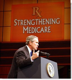 "President George W. Bush addresses the audience at Devos Performance Hall in Grand Rapids, Mich., Wednesday, Jan. 29, 2003. ""I urged the Congress last night to put aside all the politics and to make sure the Medicare system fulfills its promise to our seniors,"" President Bush said. ""I believe that seniors, if they're happy with the current Medicare system, should stay on the current Medicare system. That makes sense. If you like the way things are, you shouldn't change. However, Medicare must be more flexible. Medicare must include prescription drugs."" White House photo by Tina Hager."
