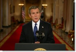 President George W. Bush addresses the nation from the Cross Hall at the White House Monday evening, March 17, 2003.  White House photo by Paul Morse