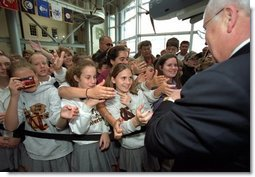 Vice President Dick Cheney shakes hands with students in New Orleans, La., after touring the National D-Day Museum with his wife Lynne Wednesday, April 9, 2003. White House photo by David Bohrer